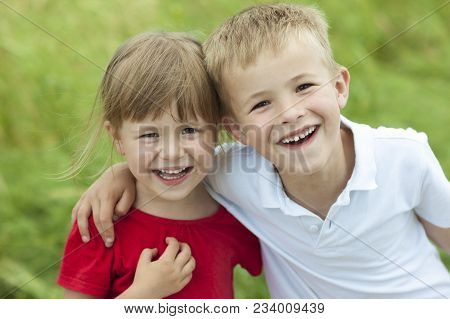 Young Boy And Girl Together Laughing Happily