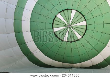 Inside Of A Green And White Hot Air Balloon As It Inflates
