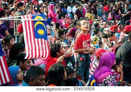 Kuala Lumpur, Malaysia : 16th September 2011 A Young Boy Standing Proud Among The Crowd Celebrating