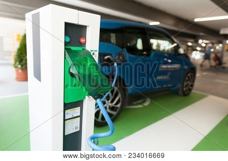 Charging Battery Of An Electric Car. Ev Charging Station.