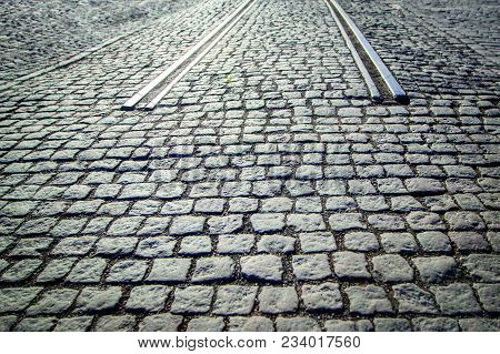 Cobbled Paving Road With Beginning Of Rails - Beginning / End Of Road.