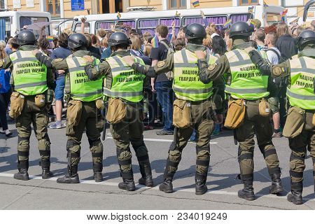 Kiev, Ukraine - June 18, 2017: Soldiers Of The National Guard Guard Participants Of The March Of Lgb