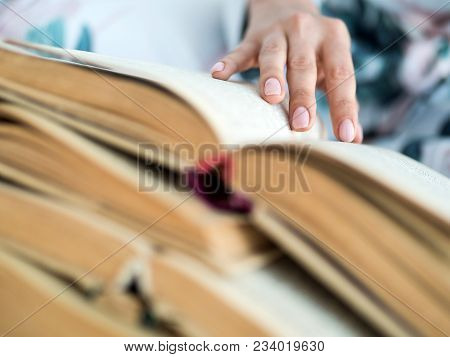 Female Hand With A Lot Of Open Books.