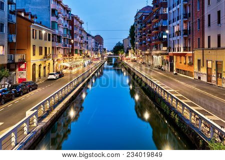 Milan - May 16, 2017: Naviglio Grande Canal At Dusk In Milan, Italy. Naviglio Grande Is One Of The M