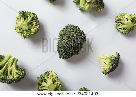 Top View Of A Fresh Organic Broccoli Florets. Focus On The Broccoli Piece In The Middle