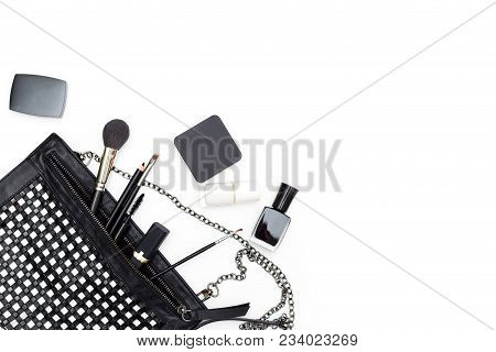 Female Cosmetics And Handbag In Black And White On A White Background. Copy Space