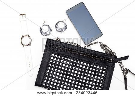 Accessories And A Black And White Handbag On A White Background. Monochrome Flat Lay
