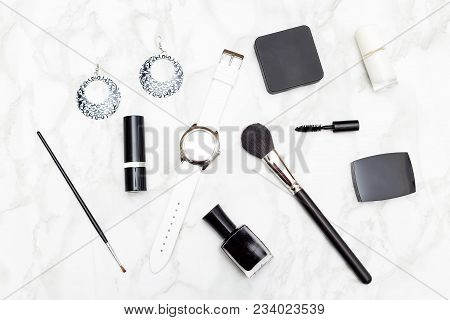 Cosmetics And Accessories Black And White On A Marble Background. Flat Lay