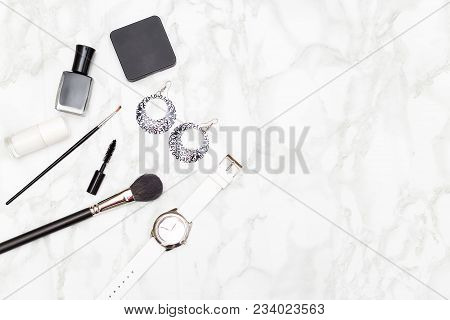 Cosmetics And Accessories Black And White On A Marble Background. Copy Space