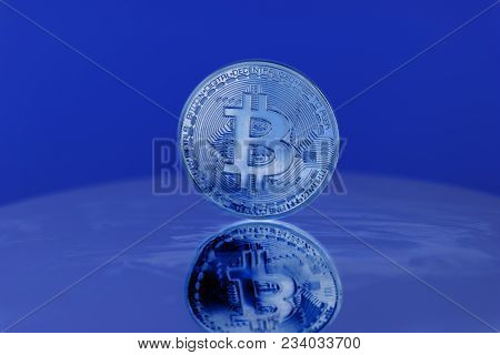 Bitcoin Crypto Currency On A Blue Background.
