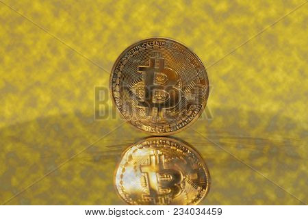 Golden Bitcoin Crypto Currency On A  Yellow.