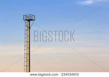 Observation Tall Tower In An Agricultural Area.