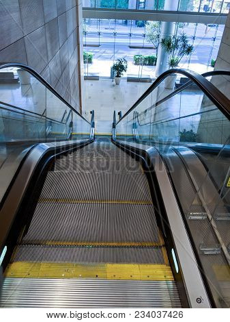 Escalator Moving Staircase Between Street Entrance To A Shopping Mall And Next Floor Level