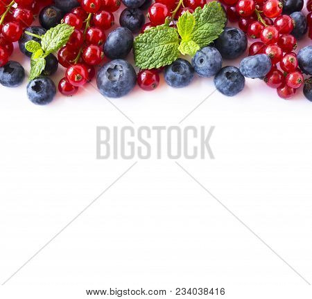 Mix Berries On A White Background. Berries And Fruits With Copy Space For Text. Ripe Blueberries, Re