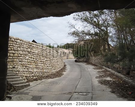 Street View Of Path And Tall Wall Made From Stone On Naked Island