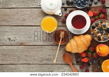 Delicious Breakfast Background. Tasty Croissants, Muesli And Fresh Sweet Organic Berries For Morning