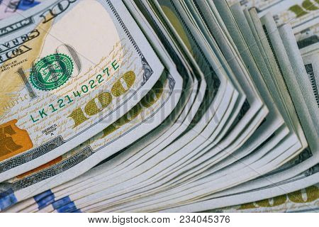 Dollars Rolled Closeup. American Dollars Cash Money. One Hundred Dollar Banknotes. Lots Of Dollar Ba