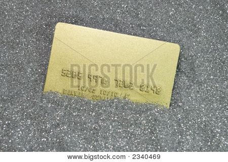gold credit card on silver texture of dots poster