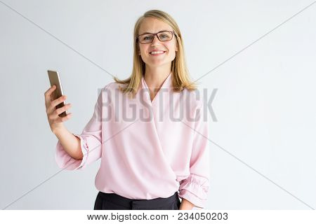 Happy Successful Lady Using Video Call On Phone While Talking To Colleague. Smiling Pleased Business