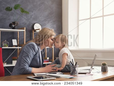 Beautiful Business Mom Working On Laptop While Spending Time With Her Cute Baby. Business, Motherhoo