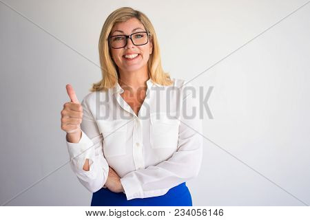 Closeup Portrait Of Smiling Middle-aged Attractive Fair-haired Woman Looking At Camera And Showing T