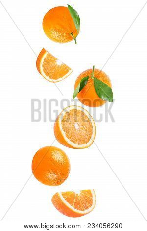 Isolated Flying Fruits. Isolated Falling Orange Fruit On White Background With Clipping Path As Pack