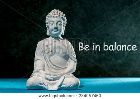 Be In Balance - Inspiration Phrase With Little White Meditate Buddha. Zen, Yoga And Life Concept.