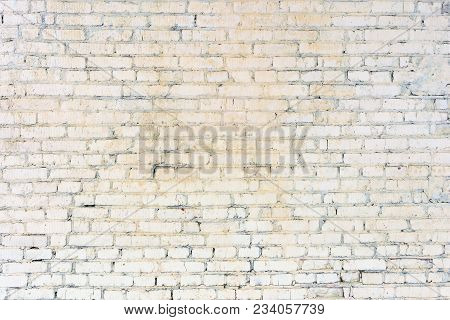 The Brick Wall Is Made Up Of Unseen Rows. Light Blank Background. Texture Of Masonry.