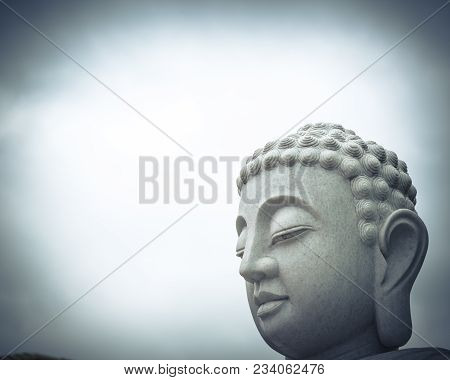 Close-up Statue Of Buddha Standing Head Isolated On White