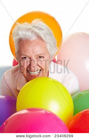 Senior Woman Having Fun With Balloons