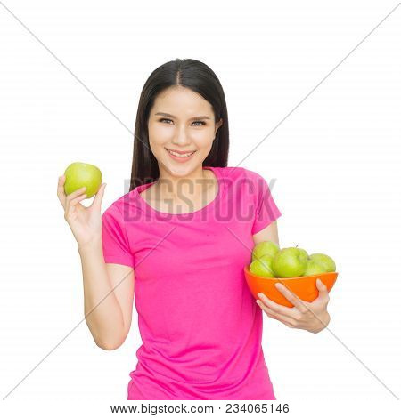 Portrait Of Lovely Young Woman Holding A Fresh Green Apple In Bowl And Smiling Isolated On White Bac