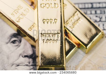 Shiny Gold Bullions Ingot Stack On America Us Dollar Banknote Money As Financial Asset, Investment A