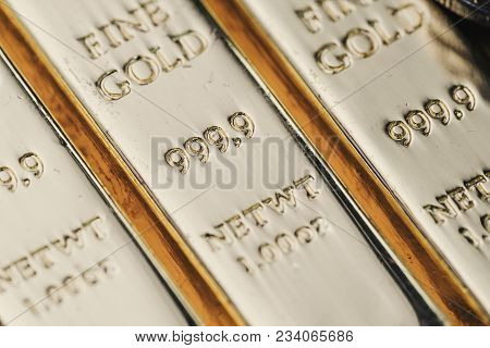 Pure 999.9 Shiny Fine Gold Bullions Ingot Bars, Closed Up Macro Shot As Financial Asset, Investment