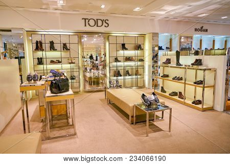 MILAN, ITALY - CIRCA NOVEMBER, 2017: TOD'S shoes on display at Rinascente shopping center in Milan. Rinascente is a collection of high-end stores.