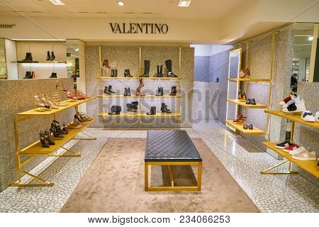 MILAN, ITALY - CIRCA NOVEMBER, 2017: Valentino shoes on display at Rinascente shopping center in Milan. Rinascente is a collection of high-end stores.