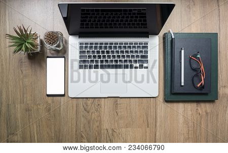 Top View Mock Up Of Blank Screen Laptop On The Desk. Work Space Mock Up White Tabletop ,smartphone W