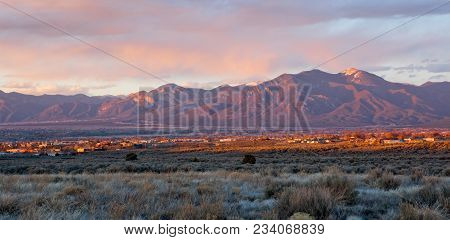 Taos Valley, New Mexico At Sunset Viewed From Llano, With Sangre De Cristo Mountains In The Backgrou