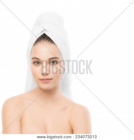 Beautiful Young Brunette Woman With Clean Face And Towel On Her Head. Beauty Spa Model Girl Perfect