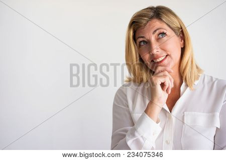 Closeup Of Smiling Mature Caucasian Woman Leaning Chin On Hand And Looking Up In Happy Thoughts. Fem