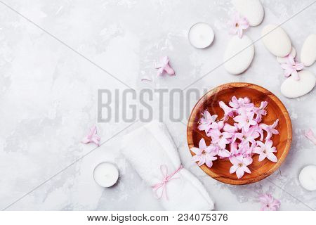 Spa, Aromatherapy, Beauty Background With Massage Pebble, Perfumed Flowers Water And Candles On Ston