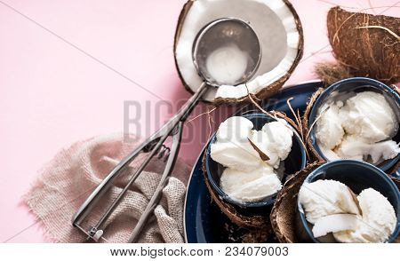Natural Coconut Ice Cream On A Pink Background With A Spoon For Ice Cream, The Concept Of Summer And