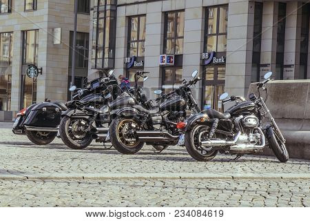Motobikes Harley Davidson Parked In A Row On St. Petersburg Street. In The City Of Dresden, Germany,