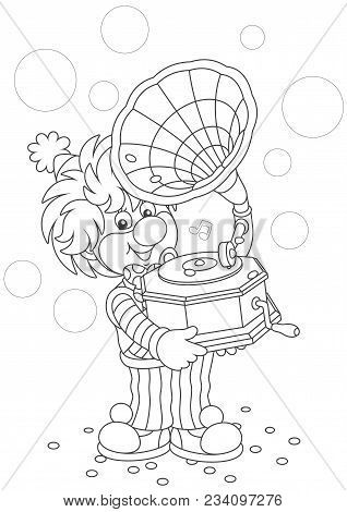 Friendly Smiling Circus Clown Listening Music From His Old Gramophone, A Black And White Vector Illu
