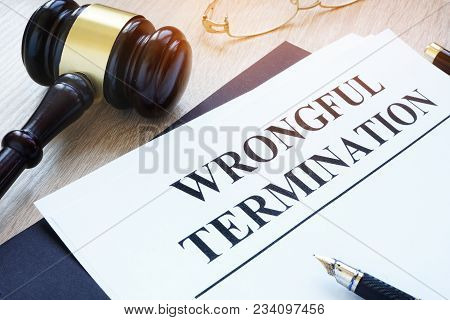 Documents About Wrongful Termination And A Gavel.