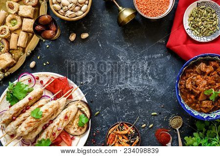 Turkish Or Arabic Cuisine. Turkish Food On Dark Stone Background, Top View With Copy Space For Text.