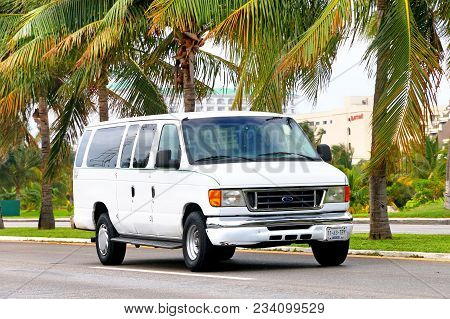 Cancun, Mexico - June 4, 2017: White Passenger Van Ford E-series In The City Street.