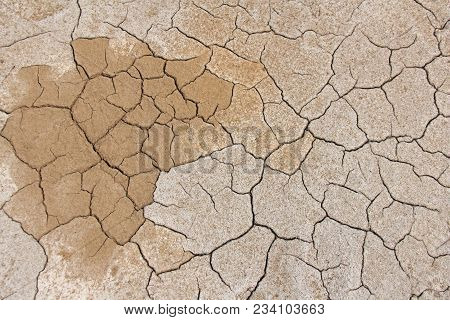 Barren Earth. Dry Cracked Earth Background. Cracked Mud Pattern. Soil In Cracks.creviced Texture.dro
