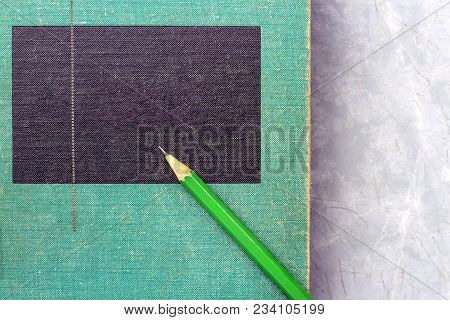 A Green Wooden Pencil Is Placed On The Hardback Or Textbook. The Concept Of Intelligence Comes From