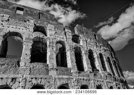 Coliseum Inner Ring Monumental Arcades With Clouds In Rome (black And White)