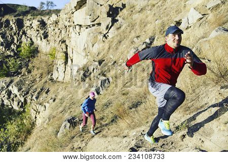 Trail Running Couple Runners Racing On Mountain Path In Volcanic Rocks Nature Landscape In Summer Ou